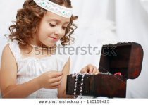 stock-photo-beautiful-little-girl-plays-with-mother-s-jewelry-close-up-140159425