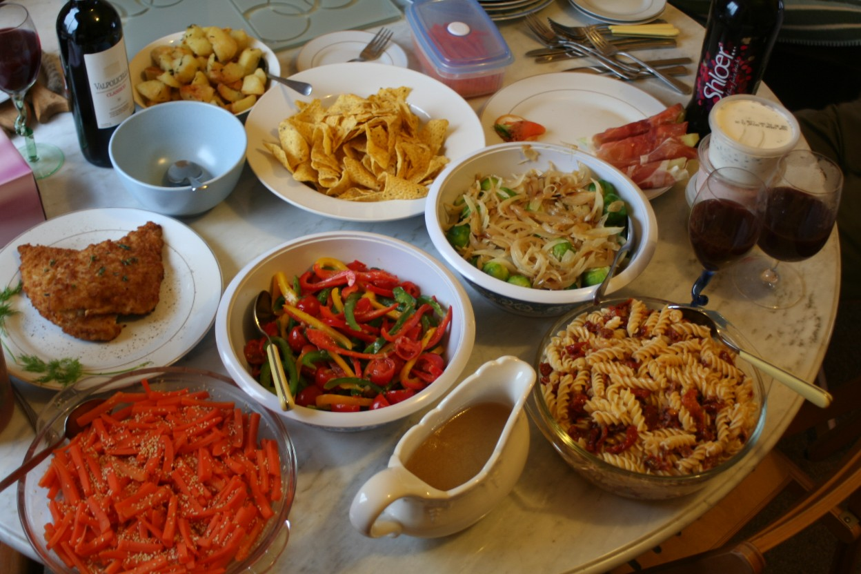 Family dinner table with food -  Capsicum And Bamboo Xmas Lunch